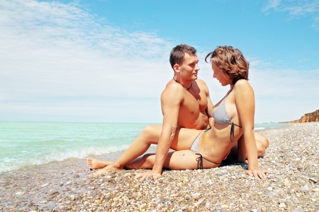 Young beautiful pair rests on the beach Stock Photo - 8952176