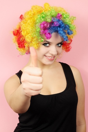 clown shows the gesture of the okey photo