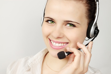 Support phone operator in headset on gray Stock Photo