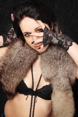young sexual woman in the gloves and the fur photo