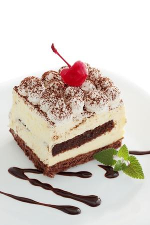 tiramisu: pastry tiramisu with the mint and the cherries  Stock Photo