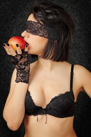 sexual woman in the linen with the red apple photo