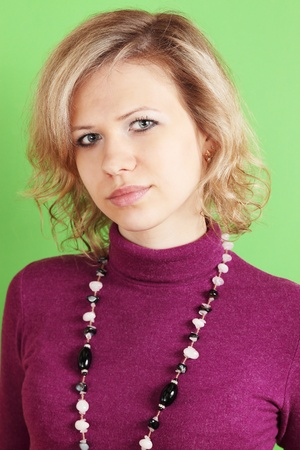 portrait of blond against the green background Stock Photo - 9593051