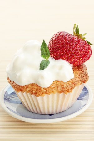 cake with the cream and the strawberries photo