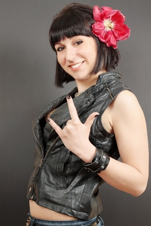 woman  shows the gesture I love you  metal sign  photo