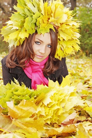 beautiful woman in the wreath from yellow leaves Stock Photo - 9862958