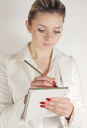 Business woman writes into the notebook the information Stock Photo - 9972282