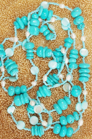 Beads from the turquoise on the golden beads photo