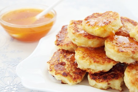Pancakes with the cottage cheese are fried in deep-fry