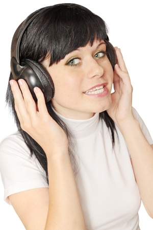 Joyful woman  in the head sets on white background photo