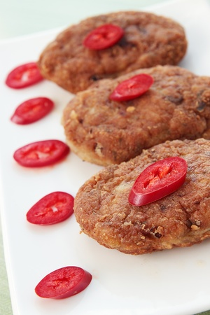 Fried cutlets with the pepper of chilies photo