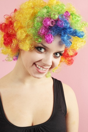 Beautiful smiling girl in the wig of the clown photo