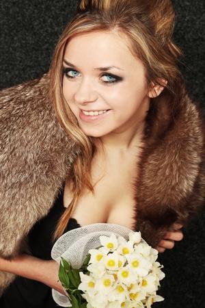 Portrait of beautiful girl in the fur collar photo