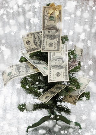 new-year fir tree is decorated with the dollars photo