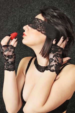sexual woman in the linen with the red strawberry photo
