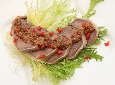 Beef Tongue and lettuce with the mustard sauce Stock Photo