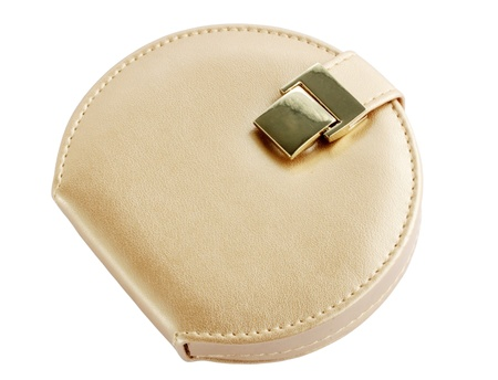 Stylish beige cosmetician with the golden buckle Standard-Bild