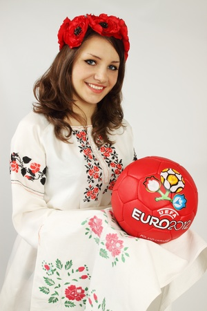 Ukrainian holds ball with the logotype of Euros 2012 Stock Photo