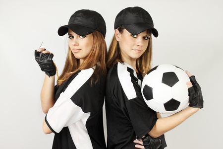 Two soccer coaches with the ball and the whistle photo