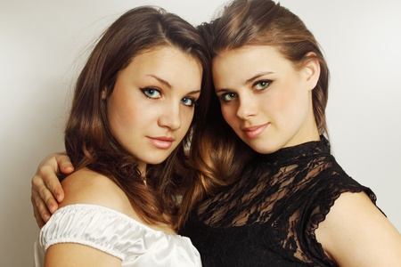 Two young girls tenderly embracing each other  Archivio Fotografico