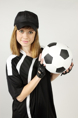 beautiful woman in the soccer form with the ball  photo