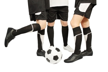 gaiters: Feet in the gaiters with the football ball