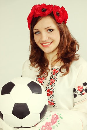 Ukrainian holds soccer ball invitation to Euro 2012 / old photo Stock Photo - 12723520