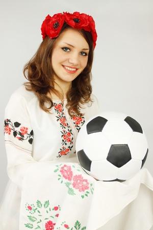 Ukrainian holds soccer ball invitation to Euro 2012 photo