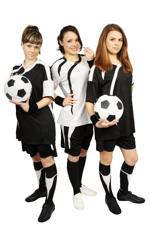 judge players: Three young girl in the football form with the balls