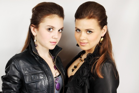 Two young women in the leather jackets and the necklace photo