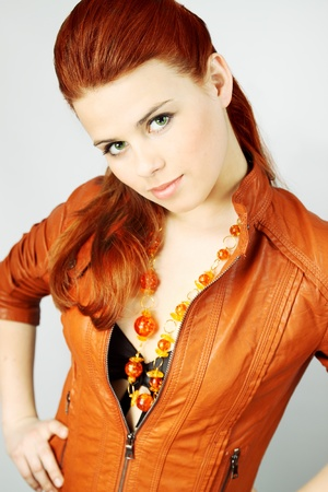 woman in the leather red jacket and the amber necklace photo