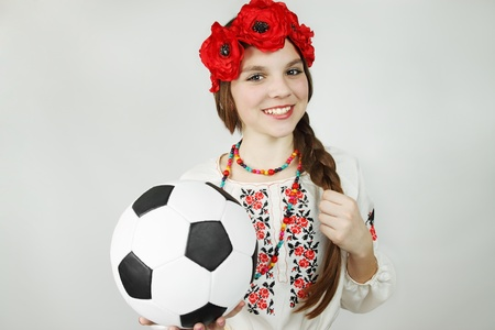 woman in the Ukrainian suit holds the ball photo