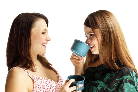 Two friends talking, drinking tea and laughing photo