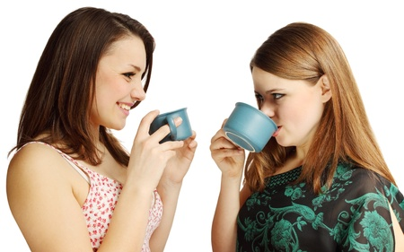 two friends talking: Two friends talking, drinking tea and laughing