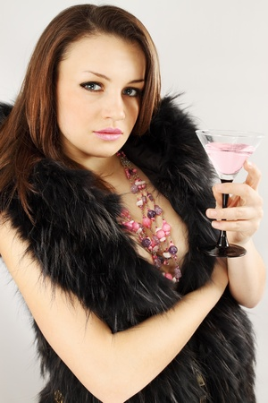 Woman in the furs and the necklace holds Martini photo
