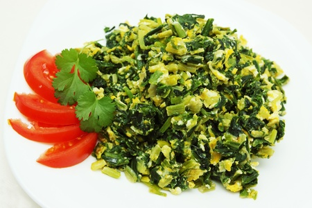 Spinach omelette with ramson, tomato and cilantro photo