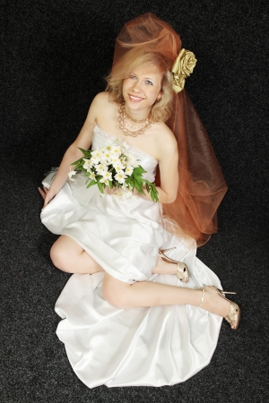 A beautiful bride with a bouquet of hellebore photo