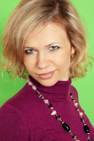portrait of blond against the green background  photo