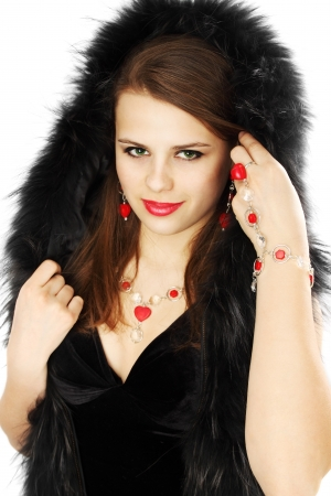 A beautiful brunette in a fur hood and jewelry photo