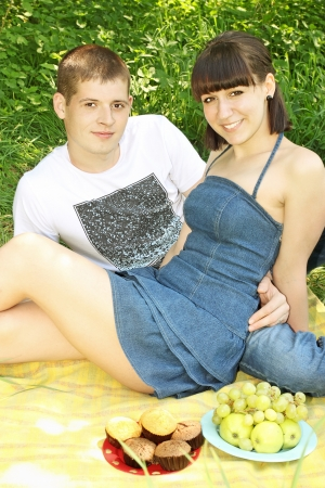 A young, beautiful couple on a picnic Stock Photo - 13606628