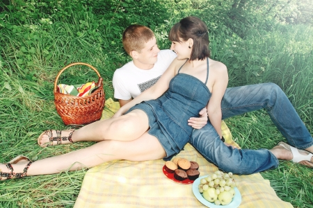 A young, beautiful couple on a picnic photo