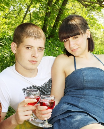 Portrait of a young couple in the outdoors with glasses of wine Stock Photo - 13606781
