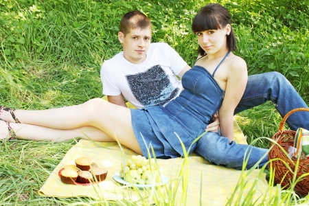 A young, beautiful couple on a picnic Stock Photo - 13606789