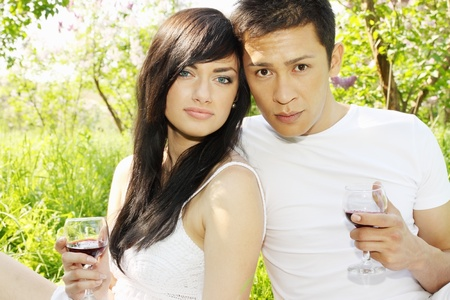 Young couple on a picnic, drink wine Stock Photo - 13606748