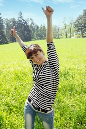 happy woman on nature shows gesture ok photo