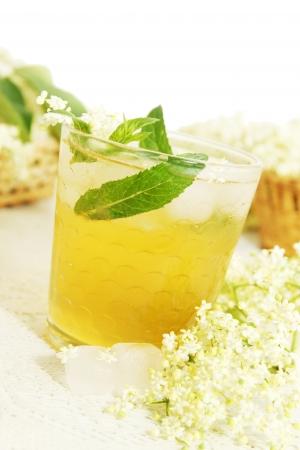 refreshing summer drink  from elder flowers  isolated on white