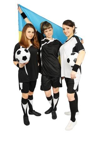 Three Ukrainian football fans with the ball and flag photo