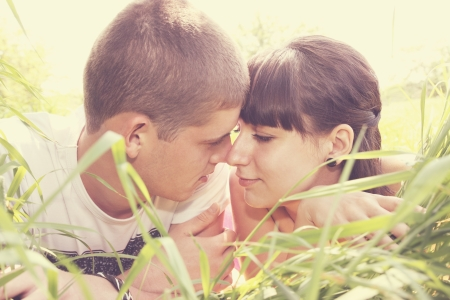 Young man and woman tenderly looking at each other Stock Photo - 13917082