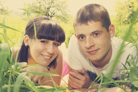 a beautiful young couple lying on grass Stock Photo - 13917098