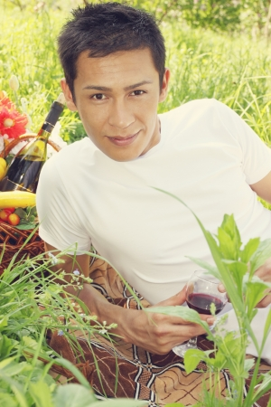A handsome man holding a glass of wine Stock Photo - 14171131